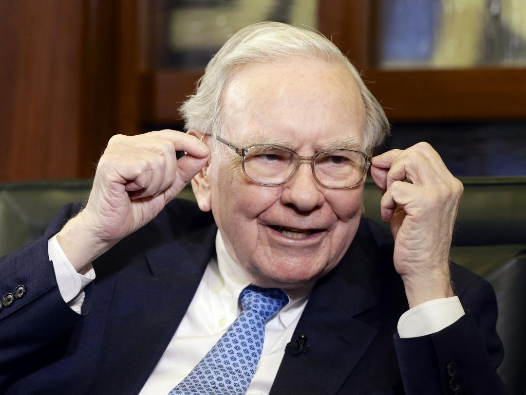 Apple buoyed by Buffett, headed for record closing high