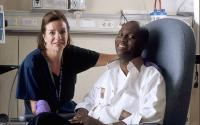 Nurse Poses with Cancer Patient
